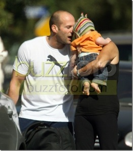 oh no! he's whispering a clever one liner into that babys ear! its going to die!