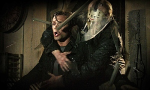 Jason in a tender moment, hugging his victim to death